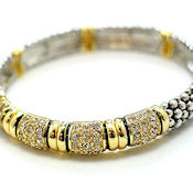 Gorgeous - swank Gold and silver design in metal and crystals. Stretch fit all!