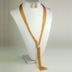 Gold multi chain tassel with clasp necklace 25in long with 3in ext and then there is the 6 inch tassel