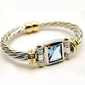 8191 $25 Designer two tone gold twisted cable magnetic blue CZ stone