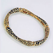 8192 $30 Beautiful black and gold stretch engraved bracelet
