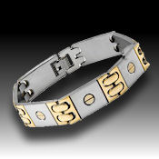 8236 $ 40 Two tone gold stainless steel 56grams, fold over clasp 14mm wide 8in long 12.5mm deep
